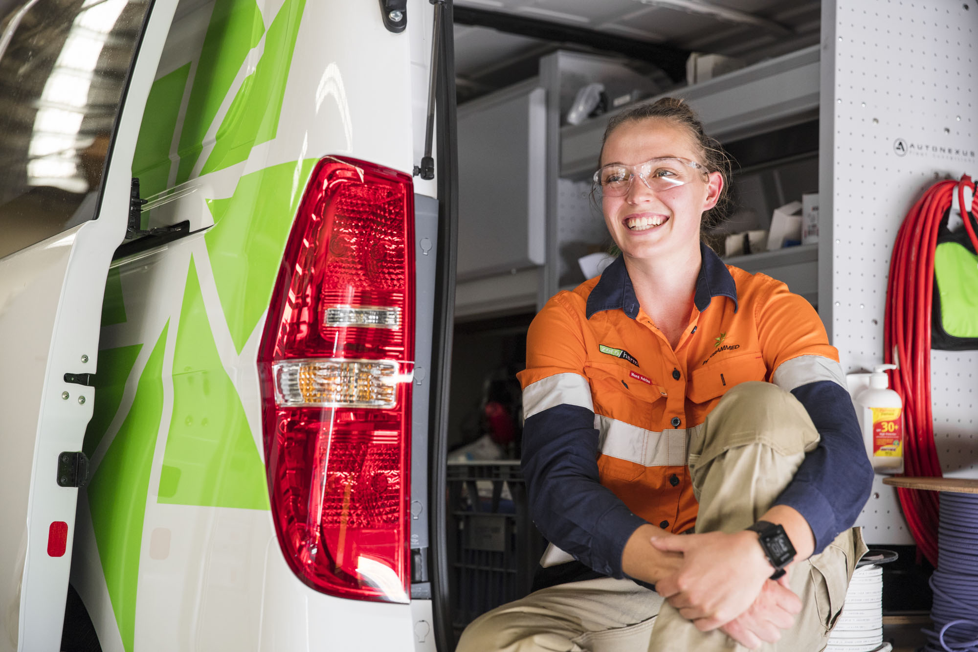 Programmed female tradie in van