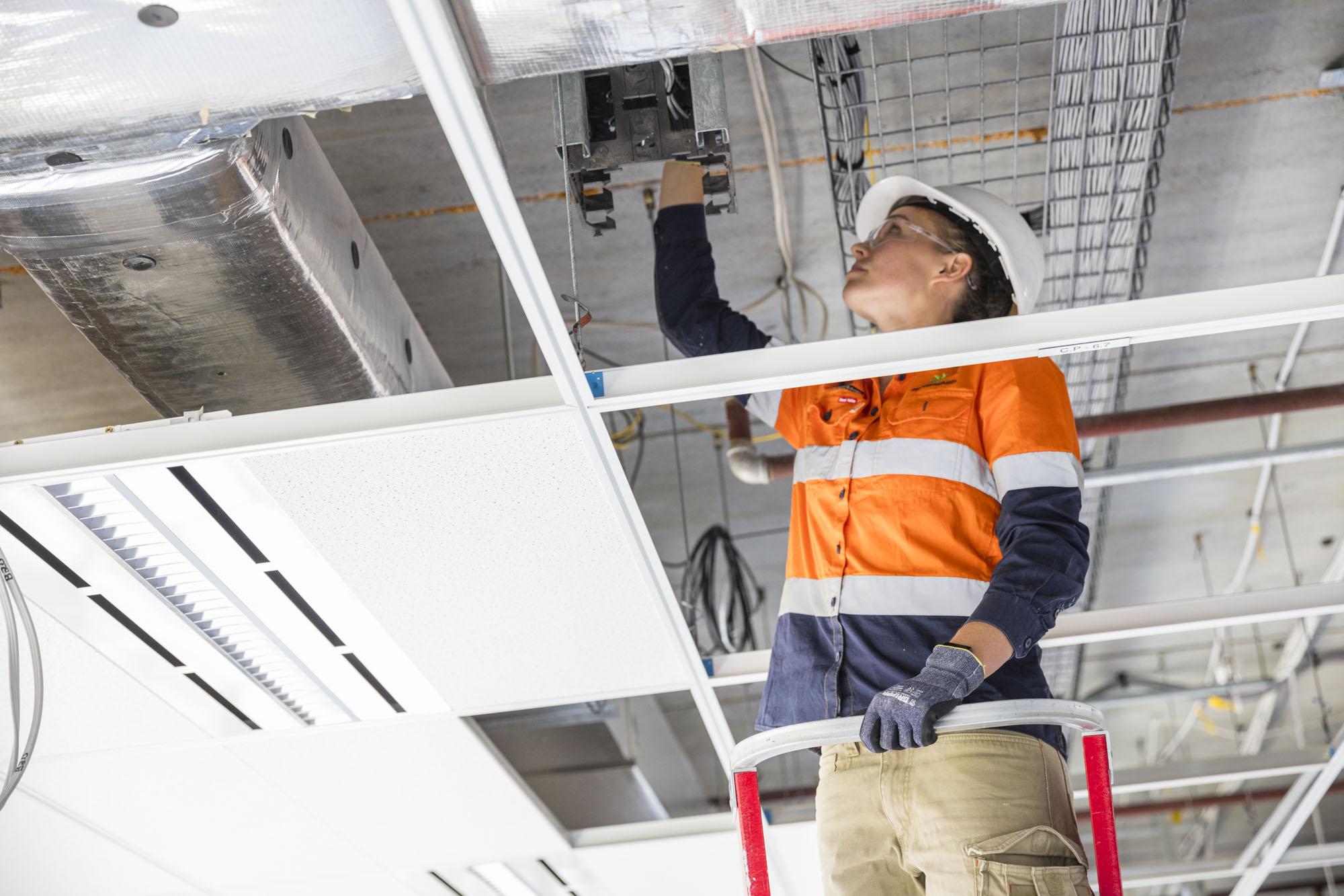 Programmed tradie working in ceiling